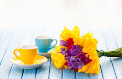 Two cups of coffee and bouquet of flowers Royalty Free Stock Photo