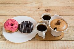 Two cups of coffee Cherry Chocolate doughnut donut stock photography