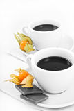 Two cups of coffee with chocolate monocrome Stock Photos
