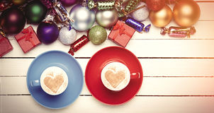 Two cups of coffee and christmas gifts. Stock Images