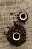 Two cups of coffee and coffee beans. On burlap background. Top view Royalty Free Stock Photos