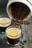 Two cups of coffee and coffee beans Royalty Free Stock Images