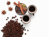 Two cups of coffee with coffee beans and spices isolated on whit Royalty Free Stock Photo