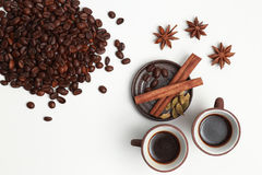 Two cups of coffee with coffee beans and spices isolated on whit Stock Photography