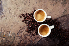 Two cups of coffee with coffee beans Stock Photo
