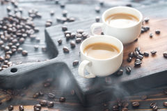 Two cups of coffee with coffee beans Stock Image