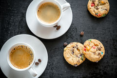 Two cups of coffee with cookies. On the dark background Stock Photos