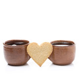 Two cups of coffee and cookies in the shape of heart Royalty Free Stock Image