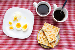 Two cups of coffee, cracker, egg, breakfast Royalty Free Stock Image