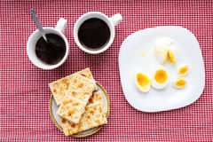 Two cups of coffee, cracker, egg, breakfast Stock Image