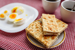 Two cups of coffee, cracker, egg, breakfast Stock Photo