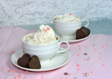 Two cups of coffee with cream Stock Image
