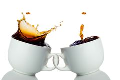 Two cups of coffee creating splashes. Love symbol Royalty Free Stock Photos