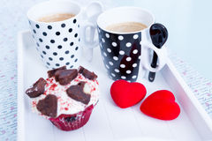 Two cups of coffee and cupcake on tray Stock Photo