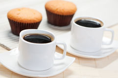 Two cups of coffee and cupcakes Stock Photography