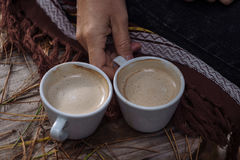 Two cups of coffee on a cut tree.  Royalty Free Stock Photography