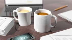 Two cups of coffee on desktop Royalty Free Stock Photos