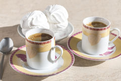 Two cups of coffee and dessert. Royalty Free Stock Photos
