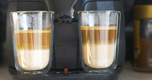 Two Cups Of Coffee Drink With Milk. On Coffee Maker Machine Panning Movement stock footage