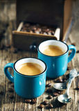 Two cups of coffee. Espresso. Two cups of coffee on wooden background. Espresso Stock Photography