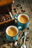 Two cups of coffee. Espresso. Two cups of coffee on wooden background. Espresso Stock Photos