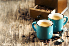 Two cups of coffee. Espresso. Two cups of coffee on wooden background. Espresso Royalty Free Stock Images