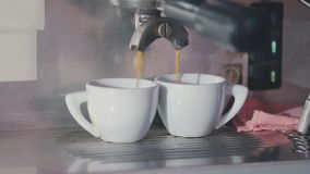 Two cups of coffee. Are filled with boiling water stock footage