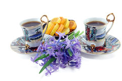 Two cups of coffee with flowers Stock Photo