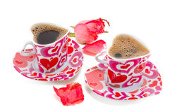 Two cups with coffee in the form of heart Stock Images