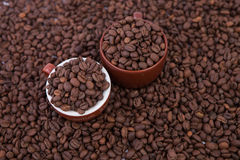 Two cups of coffee full of coffee beans. Close-up Stock Photos