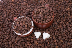 Two cups of coffee full of coffee beans. Close-up Royalty Free Stock Image