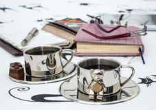Two cups of coffee, glasses, notebook in bed Royalty Free Stock Photos