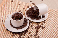 Two cups with coffee grains. Two white cups with coffee grains Royalty Free Stock Photos