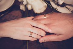 Two cups of coffee and hand of bride and groom Stock Photos