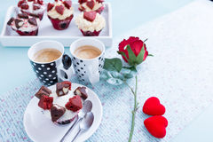 Two cups of coffee and handmade cupcake royalty free stock image