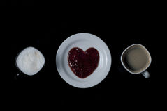 Two cups of coffee and a heart Royalty Free Stock Image