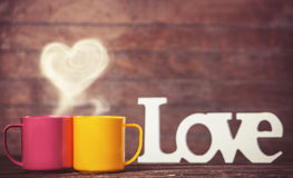 Two cups of coffee and heart shape Stock Photo