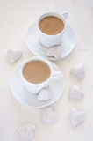 Two cups coffee with heart-shape cookies stock photography