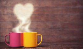 Two cups of coffee and heart shape Royalty Free Stock Photo