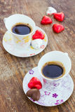Two cups of coffee with heart shaped candy Royalty Free Stock Photo