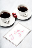 Two cups of coffee and heart shaped sweets Stock Images