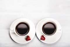 Two cups of coffee and heart shaped sweets Stock Photos