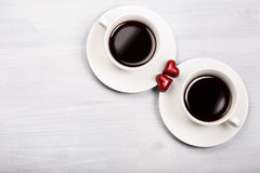 Two cups of coffee and heart shaped sweets Stock Photo