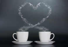 Two cups of coffee with love. On dark background stock photography