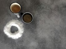Two cups of coffee and the love of sugar. stock photo