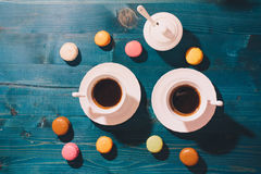 Two cups of coffee and macarons Stock Photos