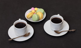 Two cups coffee and macaroon Royalty Free Stock Photography