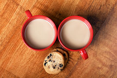Two cups of coffee with milk and cookies Stock Photo