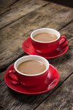 Two Cups of Coffee with Milk on old Wood Background. Royalty Free Stock Images