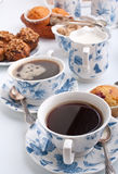 Two cups of coffee with muffins and cakes Royalty Free Stock Photography